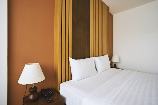 Side view of bedroom interior decoration mock up with pillows for hotel apartment