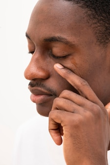Side view of black man crying