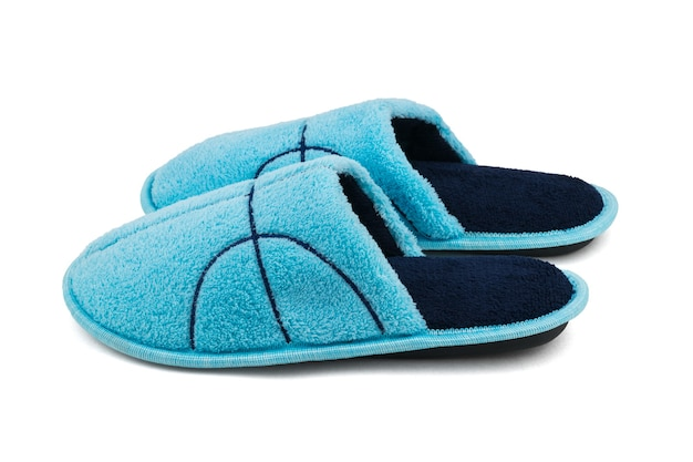 Side view of blue house slippers isolated on white surface. comfortable home shoes.