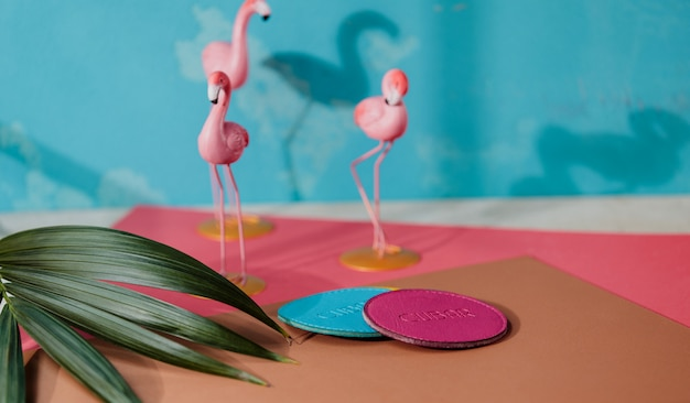 Side view of blue and pink leather coaster on pink flamingo small figures wall