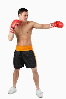 Side view of boxer hitting straight