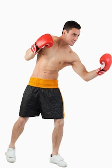 Side view of boxer performing uppercut