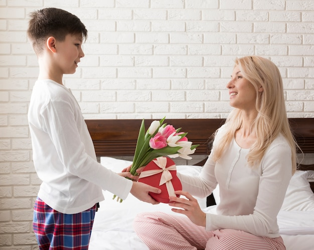 Side view boy surprising his mom