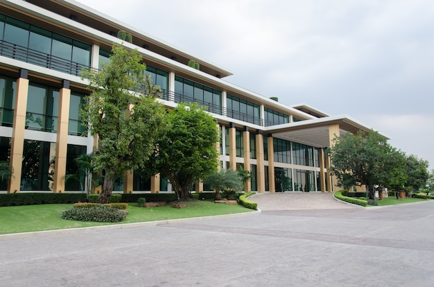 Side view of business building with cloudy sky background