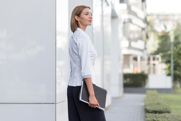Side view business woman with file