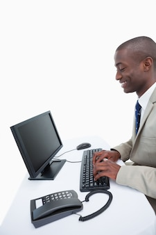 Side view of a businessman using a computer