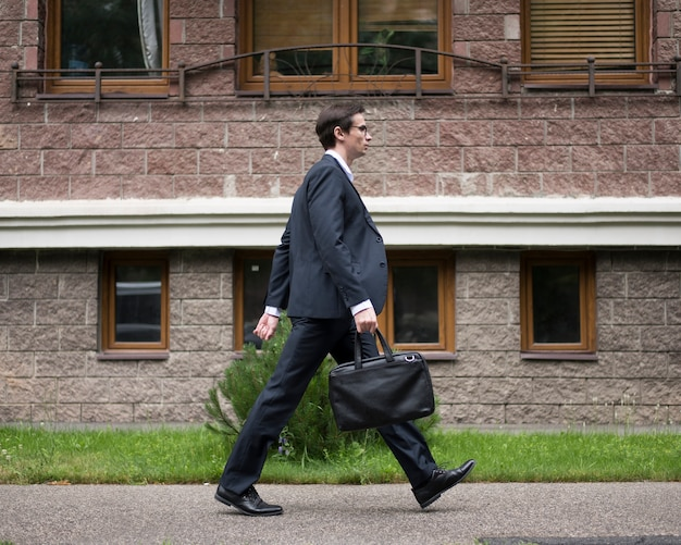 Side view of businessman walking