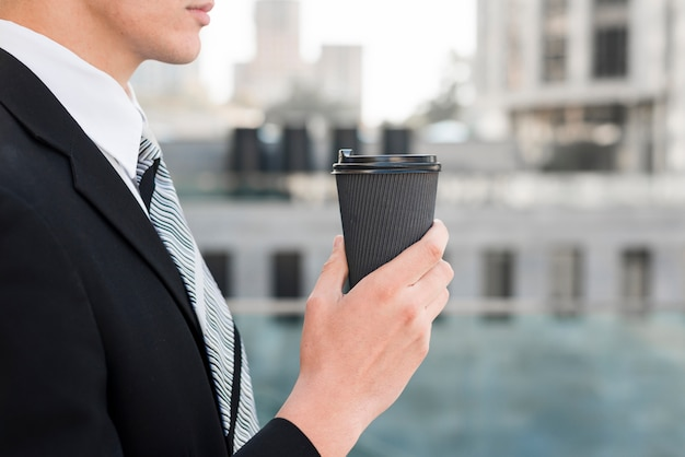 Side view of businessman with coffee