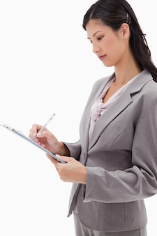 Side view of businesswoman with clipboard