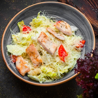 Side view caesar salad with fried chicken