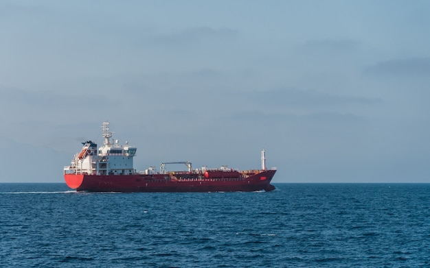 Side view of cargo vessel sailing in open sea