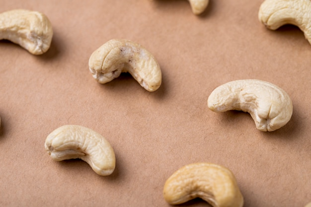 Side view of cashews isolated on old paper texture background