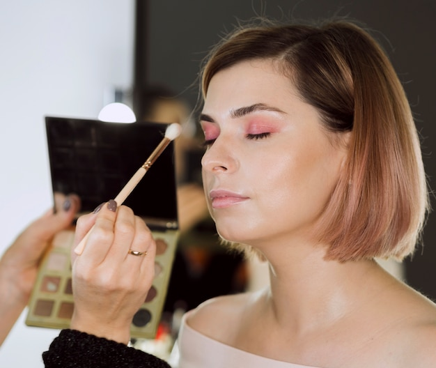 Side view of charming makeup model