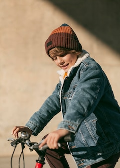 Side view of child on bike outside