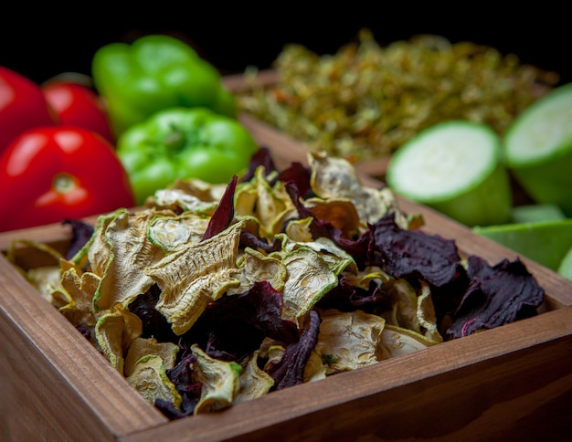 Side view close-up dried vegetables in wooden box