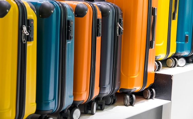 Side view of colorful suitcases