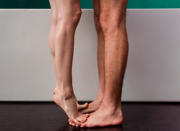 Side view of couple barefoot in bathroom