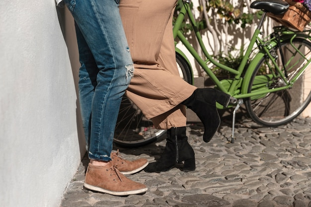 Side view of couple legs withbicycle
