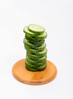 Side view cucumber sliced on wooden board