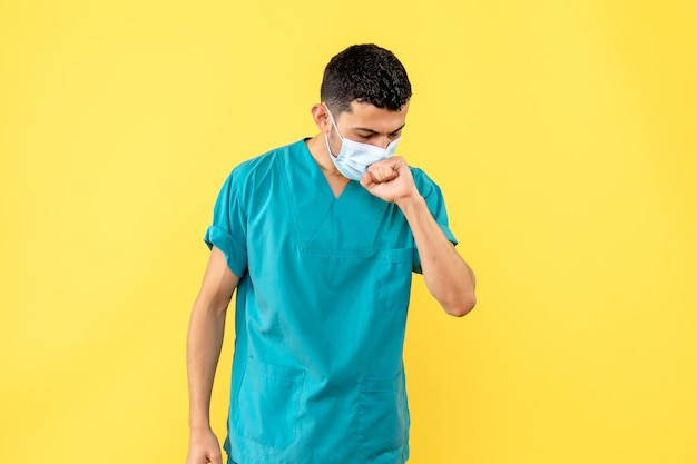 Side view of a doctor in the blue medical uniform coughs