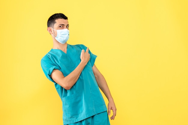 Side view a doctor a doctor in the mask is surprised by symptoms of covid-