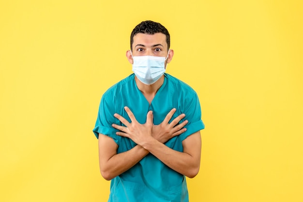 Side view a doctor a doctor in the masksays that shortness of breath is a symptom of coronavirus