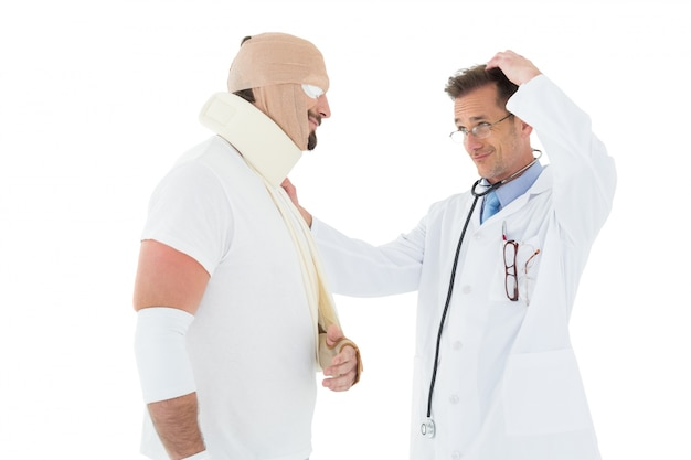 Side view of a doctor looking at patient tied up in bandage