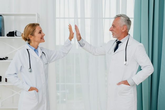 Side view doctors high five