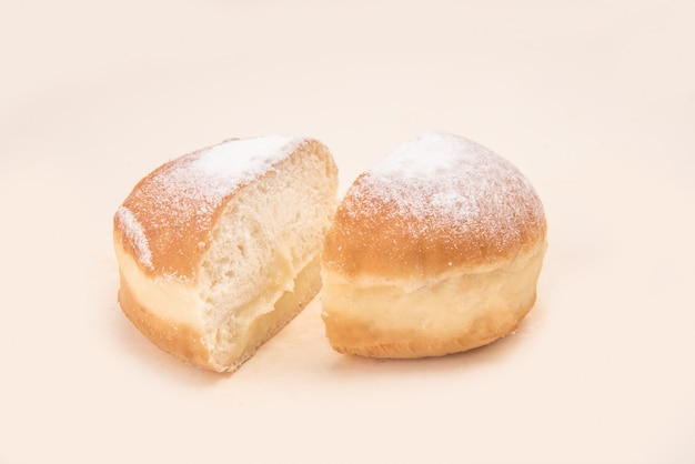 Side view of donut with powder