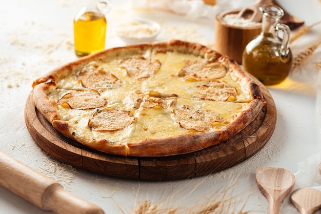 Side view on dorblu cheese pizza with pears