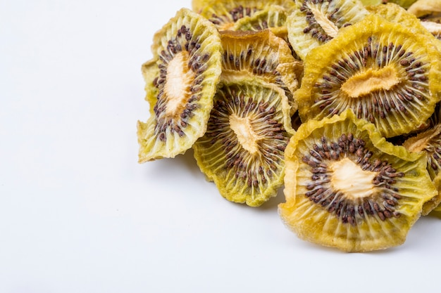 Side view of dried kiwi slices isolated on white background