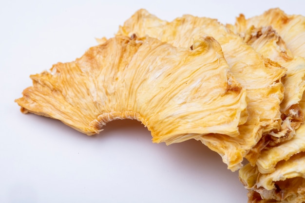 Side view of dried pineapple slices isolated on white background