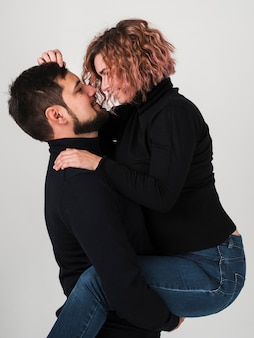 Side view of embraced couple for valentines day