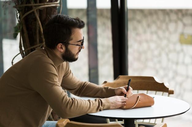 Side view entrepreneur working