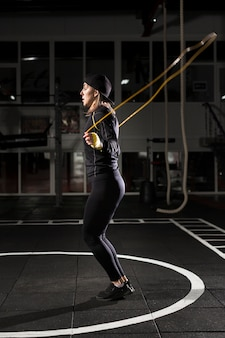 Side view of female boxer jumping rope