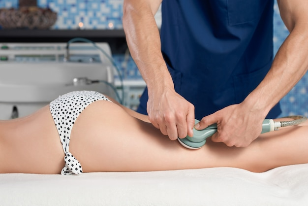Side view of female client getting anticellulite massage