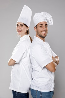 Side view of female and male chefs