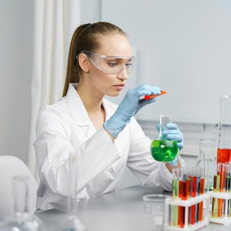 Side view of female researcher in the laboratory with test tubes