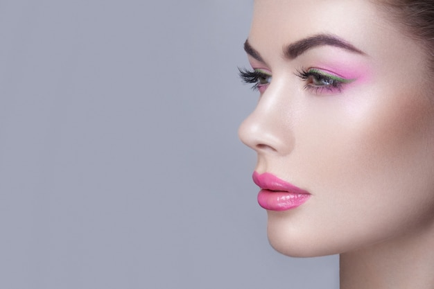 Side view of feminine face with make-up