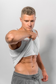 Side view of fit man showing abs