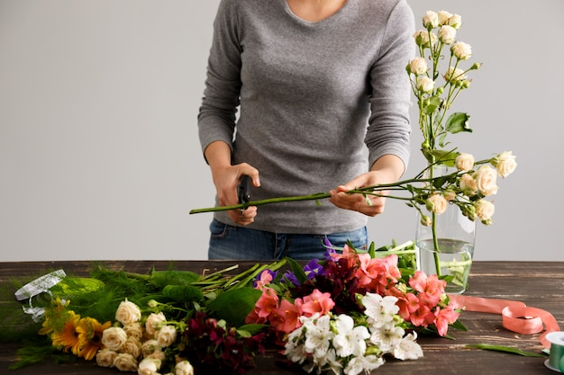 Side view of flowers, florist cutting stem.