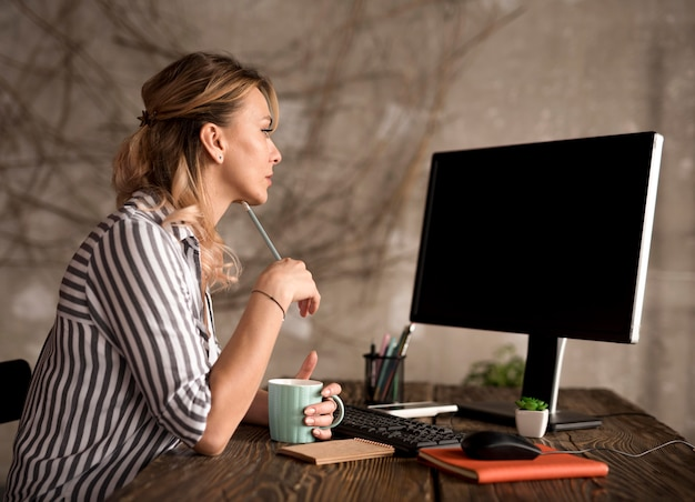 Side view freelance woman working