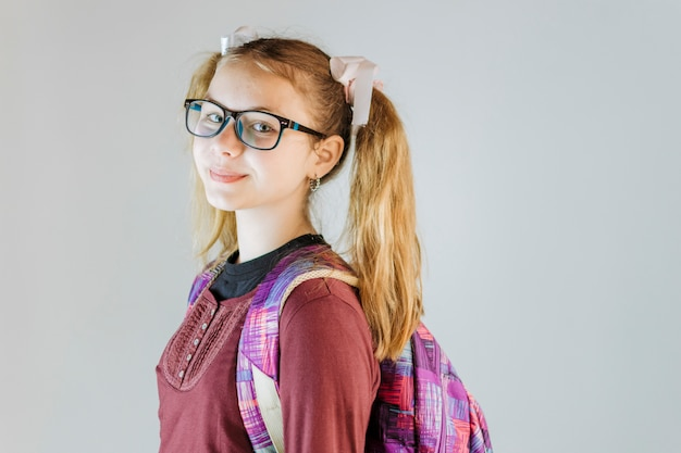Side view of a girl with backpack