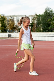 Side view of girl with jumprope