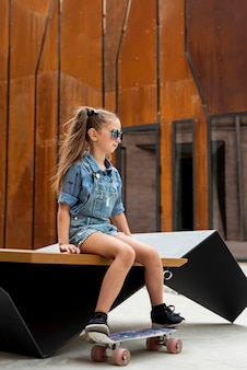 Side view of girl with skateboard