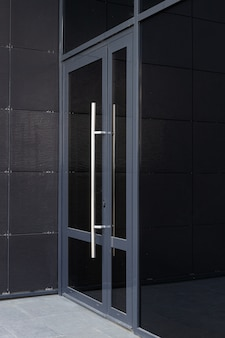 Side-view of glass door - entrance to modern office building