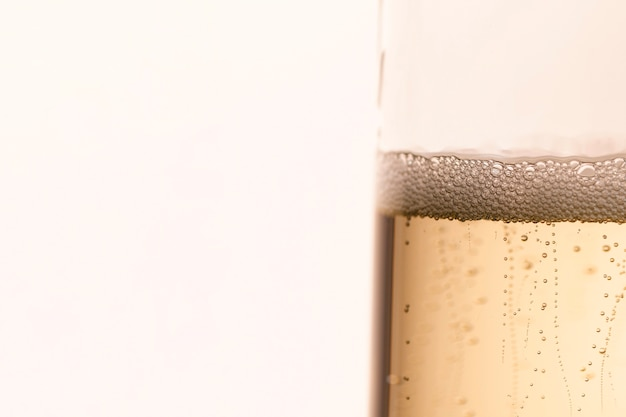 Side view glass with sparkle champagne bubbles