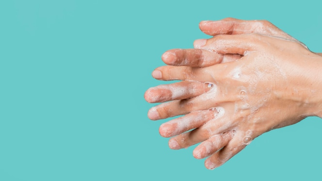 Side view of hand washing with soap and copy space