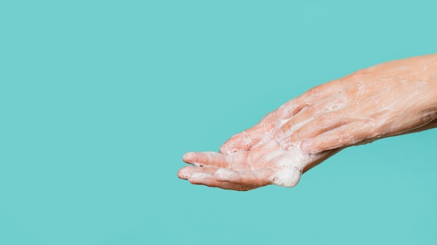 Side view of hand washing