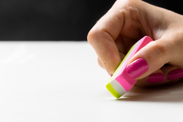 Side view of hand with rubber eraser